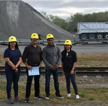 Professor Reddy with students at steel mill