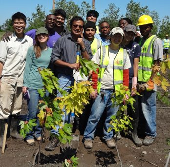Professor Reddy and students planting trees
