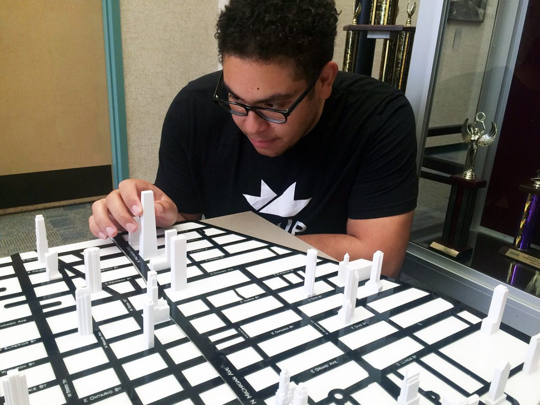 student working on scale model of Chicago's downtown