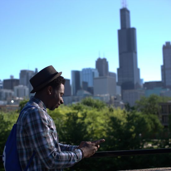student with chicago skyline in background