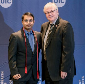 Sudheer Ballare, a PhD candidate at UIC, and UIC Chancellor Michael D. Amiridis
