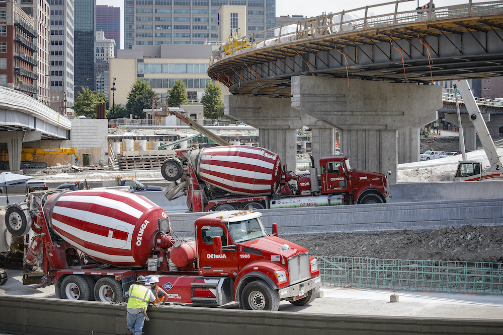 Concrete trucks on the site of highway construction