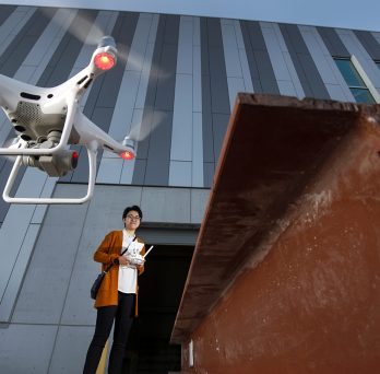 CME alumna Nalin Naranjo working with a drone